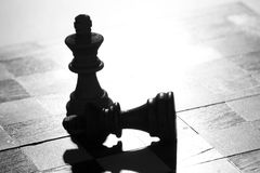 Victory. Two pieces of chess, one has won against the other Stock Image