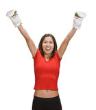 Victory. Happy young woman in boxing gloves, with her hands up, isolated against a white background Stock Images