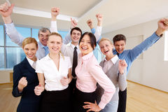 Victory. Portrait of successful people raising hands showing gladness Royalty Free Stock Images