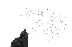 Victory. Birds flying over a status of two european soldiers in a defending position royalty free stock photo