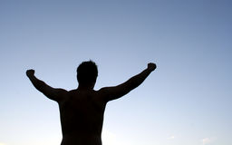 Victory. Silhouette of man holding his arms in the air Royalty Free Stock Photos