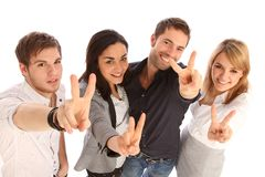 Victory. Four young people giving a victory-sign royalty free stock photo