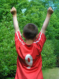Victory. – a boy just having shot his first goal stock photos