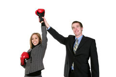 Victory. A business man raising his partners hand in success stock images