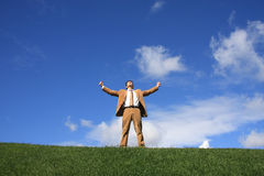 Victory 2. A business man standing with fists clenched in victory stock photography