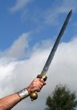 Victory. A Roman Sword held toward the sky royalty free stock image