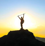 Victory. A tourist celebrating victory on top of a mountain during sunset stock photos