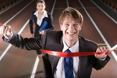 Victory. Happy business man is winning a business race Royalty Free Stock Photos