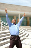 Victory. Business Man sticks his arms and hands in the air in Victory stock photography