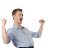 Victory!. Young man celebrating victory isolated over white royalty free stock photography
