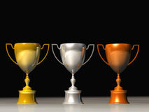 Victory. 3D Render of a Classic gold/silver/bronze  trophy cup on pedestal Royalty Free Stock Images