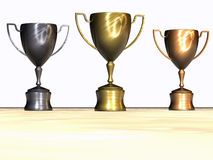 Victory. 3D Render of a Classic gold/silver/bronze  trophy cup on pedestal Royalty Free Stock Image