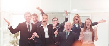 Victory in business. Successful businessman and business team on. Victory in business.  Successful business team in the office Stock Photo