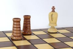On the chessboard two black rooks announced a check and mat to the white king. Victory in the chess game, on the chessboard two black rooks announced a check and Royalty Free Stock Photo