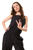 Victory concept. Young woman showing the victory sign Royalty Free Stock Images