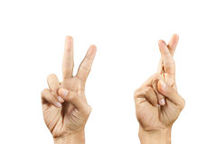 Victory and cross finger symbol. Stock Photo