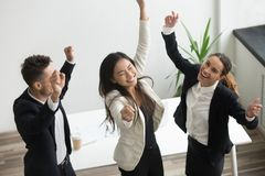Victory dance concept, excited diverse coworkers celebrating bus stock images