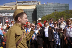 Victory Day celebration in Moscow. People sing war songs. Royalty Free Stock Photo