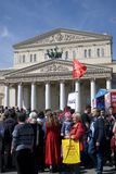 Victory Day celebration in Moscow. Red flag waves above people. Stock Image