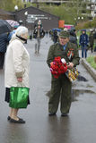 Victory Day celebration in Moscow. Senior man holds many flowers Royalty Free Stock Images