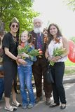 Victory Day celebration in Moscow. Young people and senior man portrait. MOSCOW - MAY 09, 2015: Victory Day celebration in Moscow. Young people and senior man Stock Photos