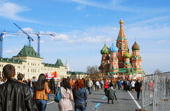 Victory Day decoration on the Red Square. A banner with May 9 at left, Saint Basils Church at right, people walking. Taken on May 01, 2013 in Moscow, Russia stock photography