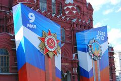 Victory Day decoration on the Red Square. Banners with medals and ribbons on the facade of Historical museum. Taken on May 01, 2013 in Moscow, Russia stock images