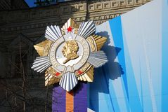 Victory Day decoration on the Red Square. Huge golden star Kutuzov's portrait, orange and violet ribbon. Taken on May 01, 2013 in Moscow, Russia stock image