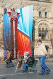 Victory Day decoration on the Red Square. Huge red star and ribbon on the GUM facade. People pass by. Taken on May 01, 2013 in Moscow, Russia royalty free stock photo