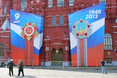 Victory Day decoration on the Red Square. Huge stars and ribbons on the facade of the Historical museum. Taken on May 01, 2013 in Moscow, Russia royalty free stock image