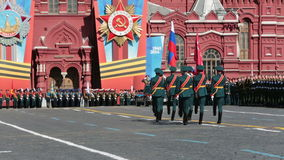 Victory Day. MOSCOW, RUSSIA - MAY 9, 2014: Celebration of the 69th anniversary of the Victory Day (WWII) on Red Square. Standard-bearers carry the banner of