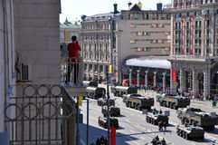 Victory day parade in Moscow, Russia. Resident of the house on Tverskaya street is watching the parade on victory day in Moscow Stock Photos