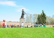 Victory day on Piskaryovskoye Memorial Cemetery. SAINT-PETERSBURG, RUSSIA - MAY 9: On Victory day people came to honor the memory of the buried soldiers on Royalty Free Stock Photo