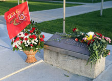 Victory day in Russia. Flowers at the memorial stone with the inscription Odessa on Victory Day. Balashikha, Moscow region, Russia Stock Photo
