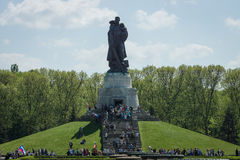 Victory Day in Treptower Park. Berlin. BERLIN - MAY 09, 2016: Victory Day in Treptower Park. Soviet War Memorial (Monument to the Liberator Soldier), and Royalty Free Stock Photography