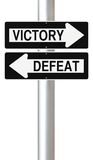 Victory or Defeat. Conceptual one way street signs on Victory and Defeat Stock Image