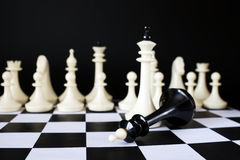 Victory and Defeat. Fallen chess king Stock Image