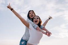 Victory in female friendship. Happy girls. Women taking selfie, modern social communication Royalty Free Stock Image