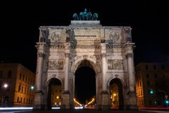 Victory gate in Munich in the night. The object is photographed at night. Illuminated and the photo shows only the lights of passing cars Royalty Free Stock Photos