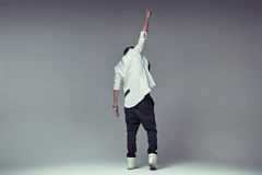 Victory gesture of a stylish guy Stock Images