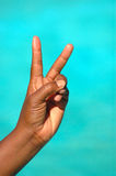 Victory hand. The black hand of an African American woman showing the symbolic victory sign after success where she was the winner Stock Photos
