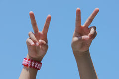 Victory hand signal. The victory hand signal in the sky Stock Images