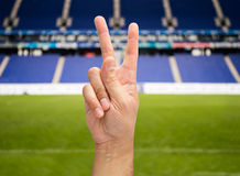 Victory. Hand with two fingers concept of victory on the stadium stock photo