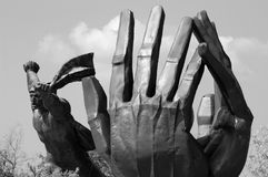 Victory in the hands. Sculpture of the hands in the park of the statue near Budapest in Hungary royalty free stock image