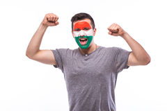 Victory, happy and goal scream emotions of Hungarian football fan in game support of Hungary national team. On white background. European football fans concept Royalty Free Stock Photos