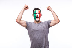 Victory, happy and goal scream emotions of Italian football fan in game support of Italy. National team on white background. European football fans concept Royalty Free Stock Images