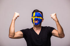 Victory, happy and goal scream emotions of Swede football fan in game support of Sweden national team Stock Images