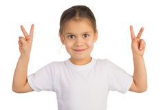 Victory. Happy little girl shows Victory sign with both hands. Isolated on white royalty free stock image