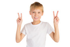 Victory. Happy young boy shows Victory sign with both hands. Isolated on white royalty free stock photo