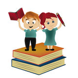 The victory of the knowledge. A beautiful couple standing above two big books Royalty Free Stock Photo
